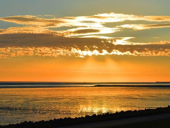 Zonsondergang boven het wad. Pixabay